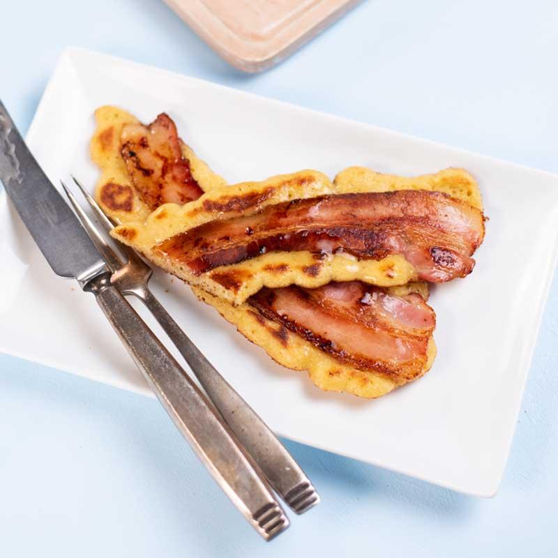 Keto Bacon Pancakes on a white plate.