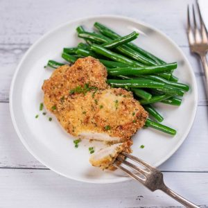 Keto Crispy Baked Ranch Chicken on a plate with green beans.
