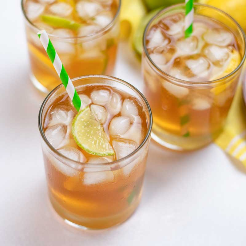 Sugar-Free Iced Tea in glasses with striped paper straws.